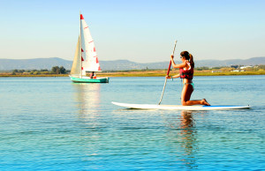 Woman practicing stand-up paddle
